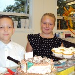 Our School Ambassadors Maisie and Luke serving cakes